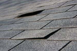A Roofing Contractor To Repair Roofing Shingles
