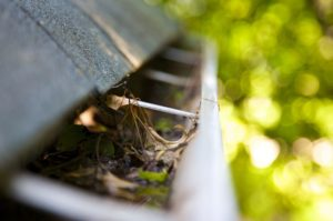 Hire Roofing Company To Clean Gutters Unclogged