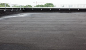 commercial flat roofing pooling