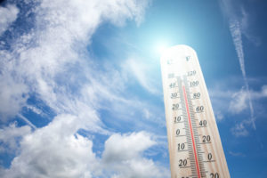 commercial flat roof sunsine heat affects roofing